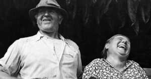 farmer and his wife laughing