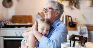 grandparent hugging grandchild