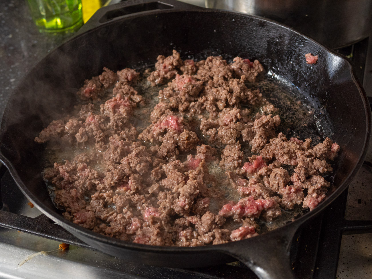 Brown beef in large skillet. Remove from pan and set aside.
