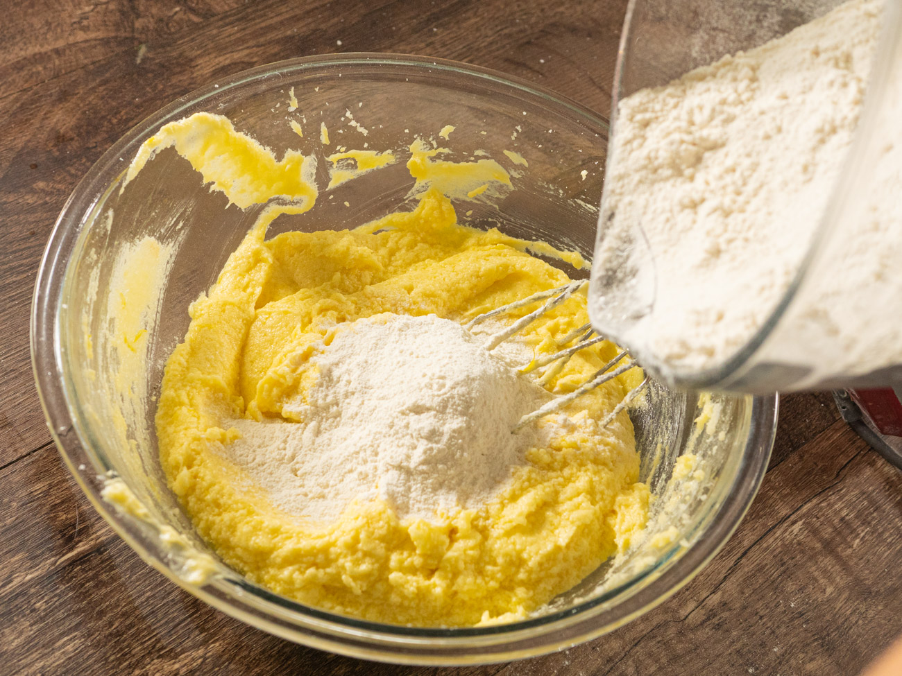In a separate bowl combine flour and salt. Slowly add the flour mixture to the wet ingredients.