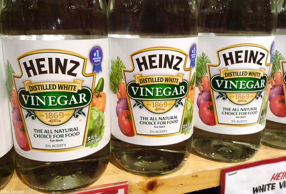 bottles of vinegar on store shelves