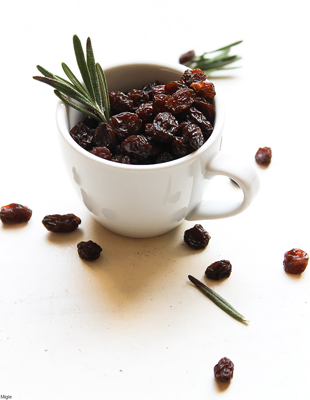 raisins and rosemary in a mug