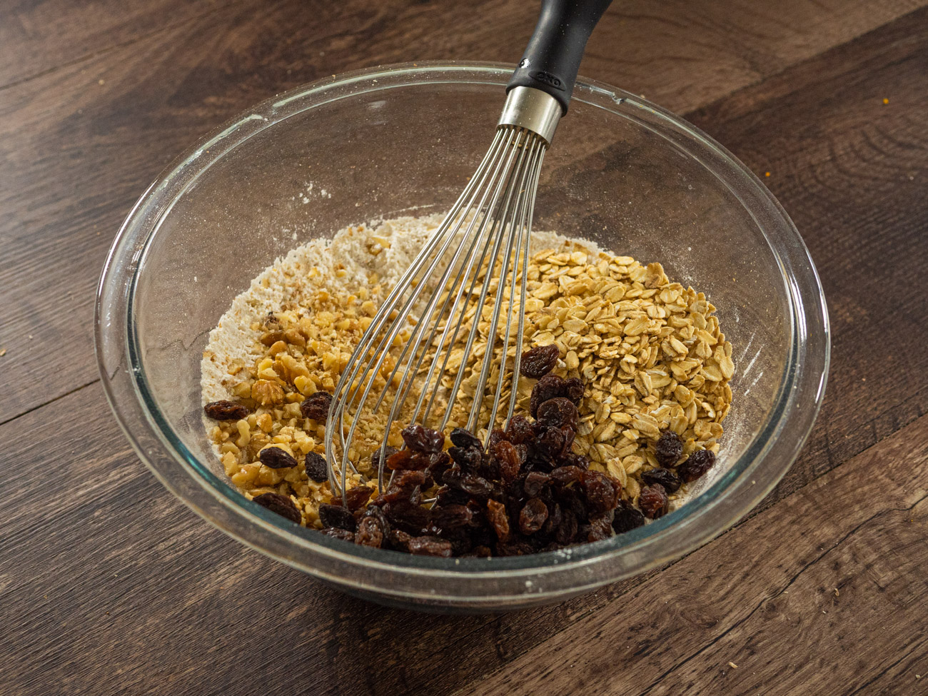 Stir in rolled oats, raisins, and walnuts.