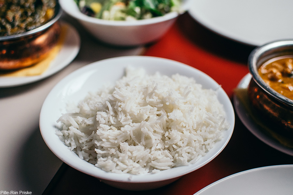 fluffy rice on a table with other prepared dishes