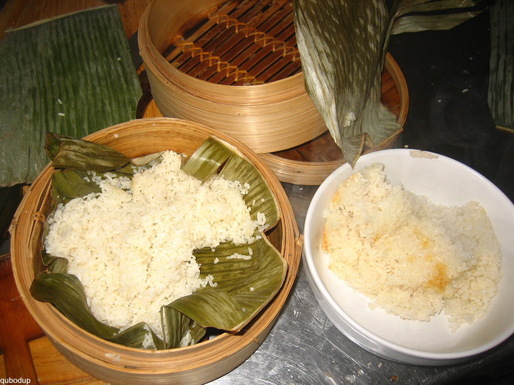 sticky rice in a bamboo steamer