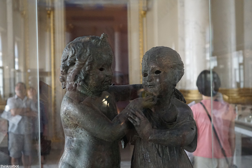 creepy bronze sculpture at the Louvre Museum