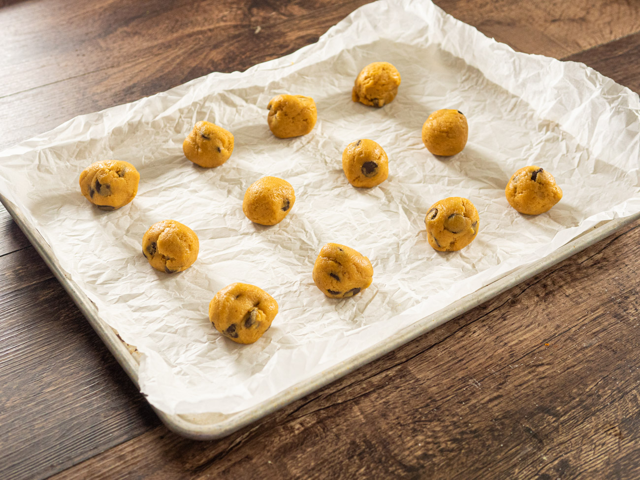 Roll into 1-inch balls or use a small ice cream scoop. Place cookies at least one inch apart on baking sheet.