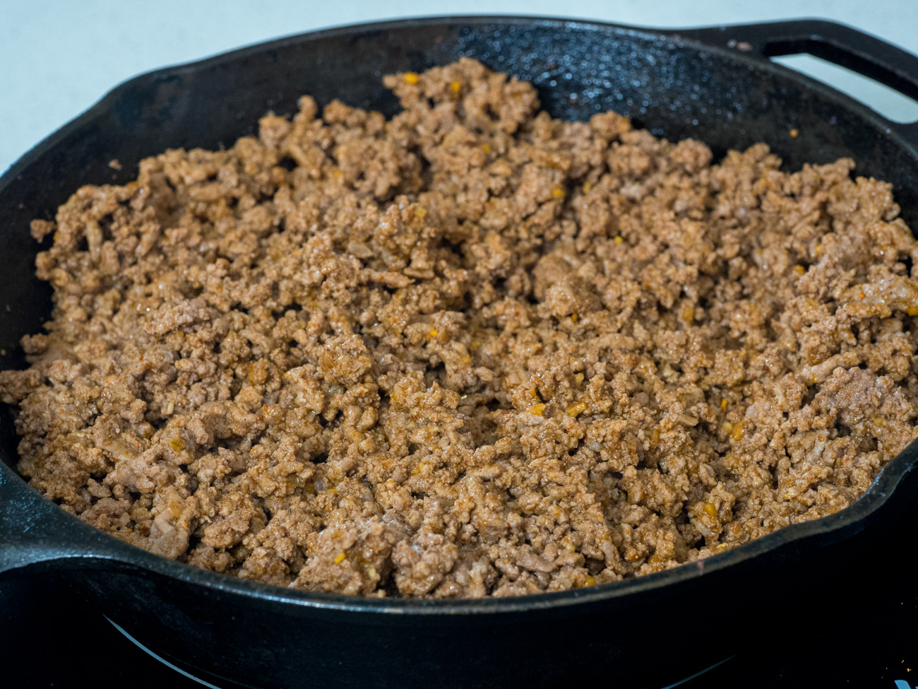 In a large skillet combine beef and taco seasoning and cook until browned. Remove beef from pan and set aside.