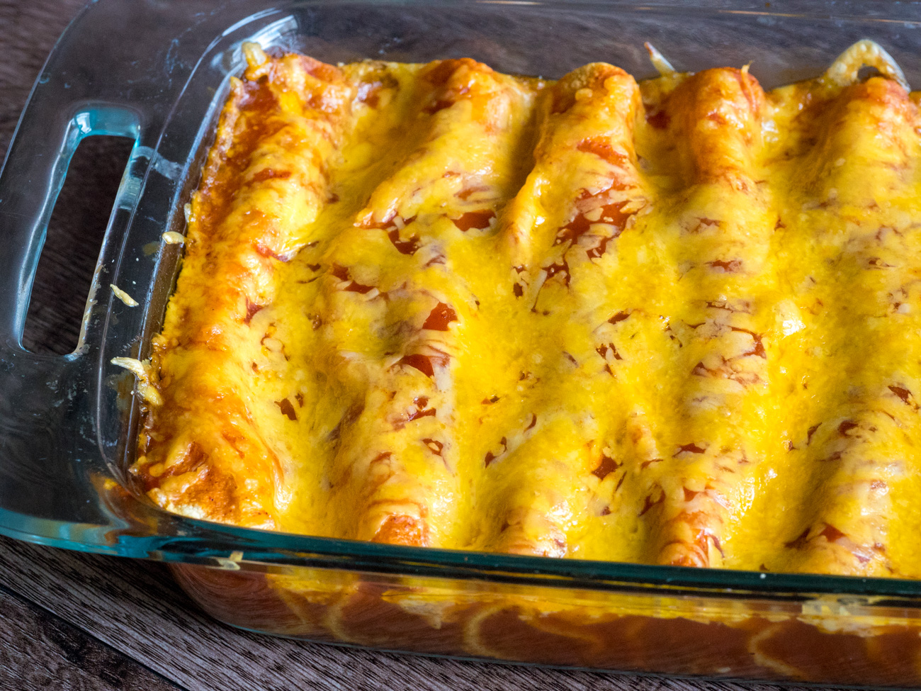 Bake until sauce is bubbly and cheese has melted, about 20 minutes. Serve with sour cream and cilantro and enjoy!