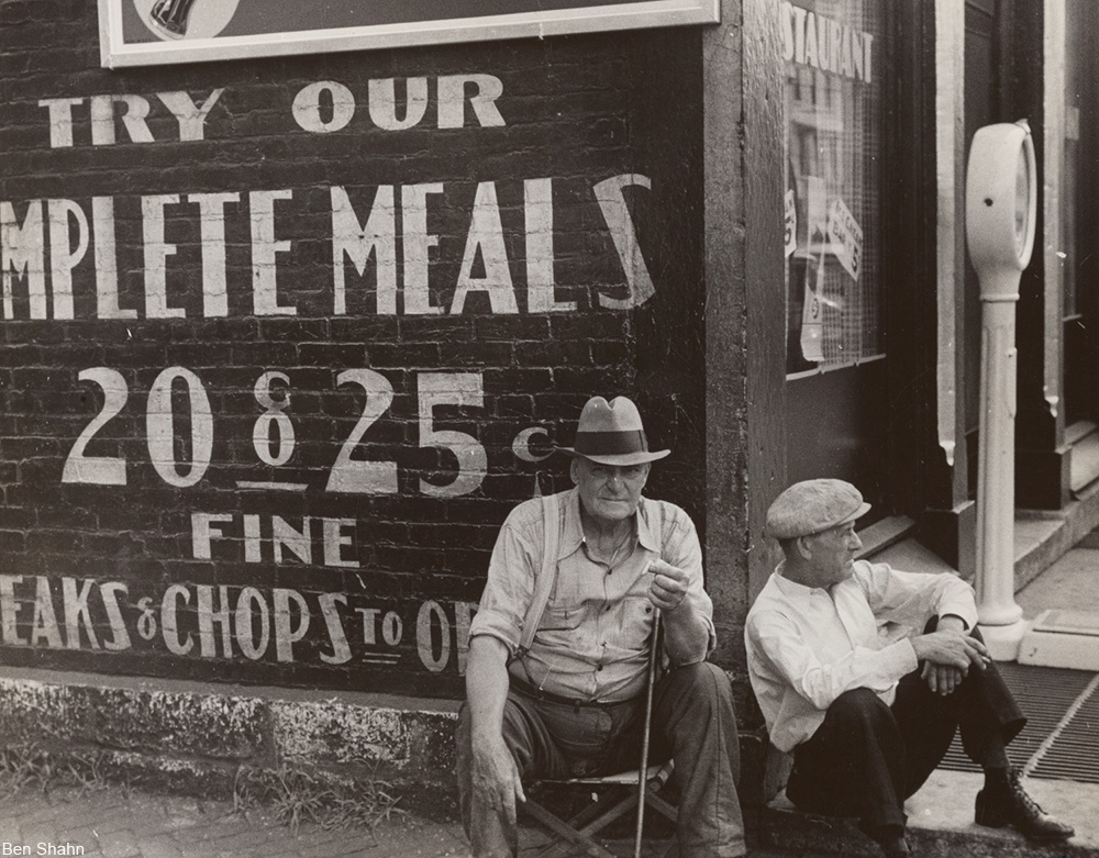 out of work men on the sidewalk, 1938