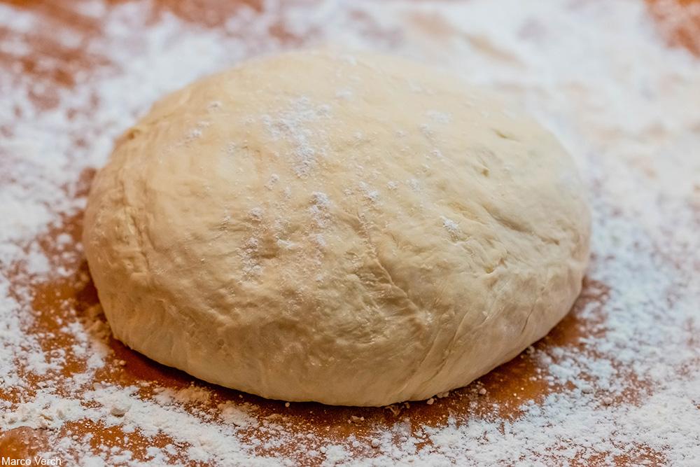 bread dough on floured wooden board