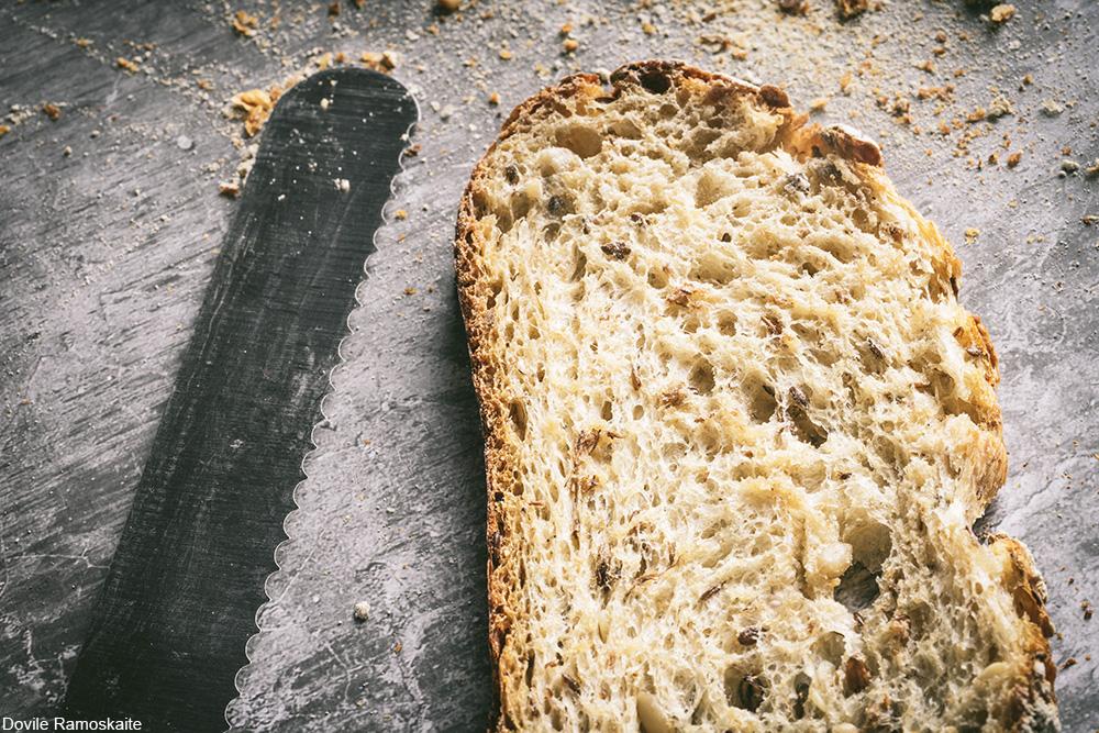 slice of sourdough bread with bread knife