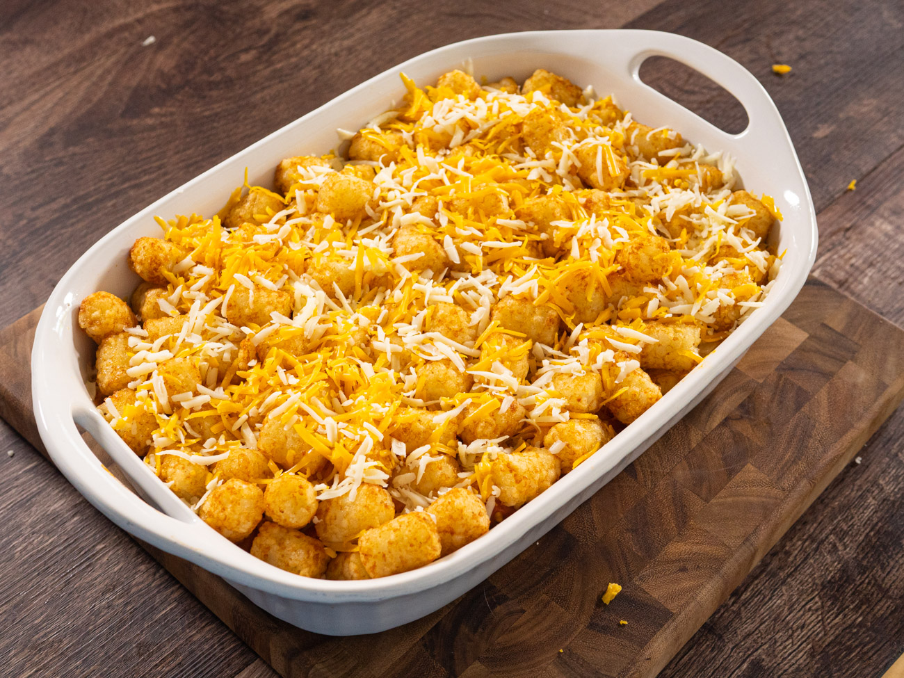 Spread the tater tots on top of the cheese layer and bake for 30 minutes.