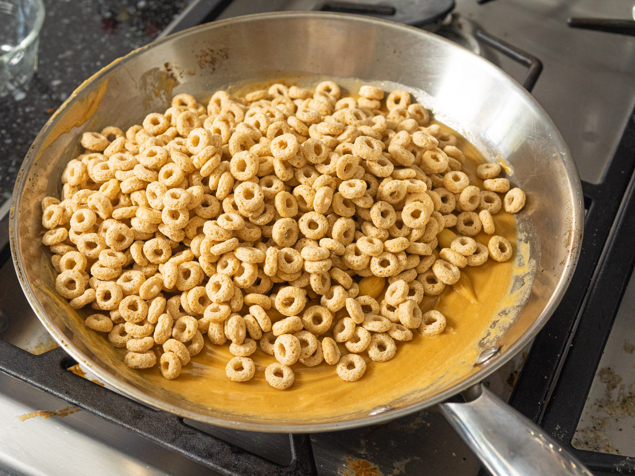 Remove from the heat and stir in the Cheerios and peanuts.