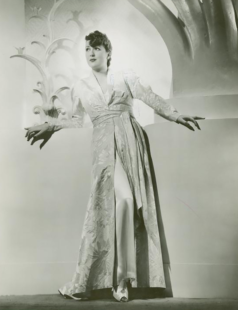 publicity photo of Gypsy Rose Lee in a dressing gown for the 1938 film, Sally, Irene, and Mary