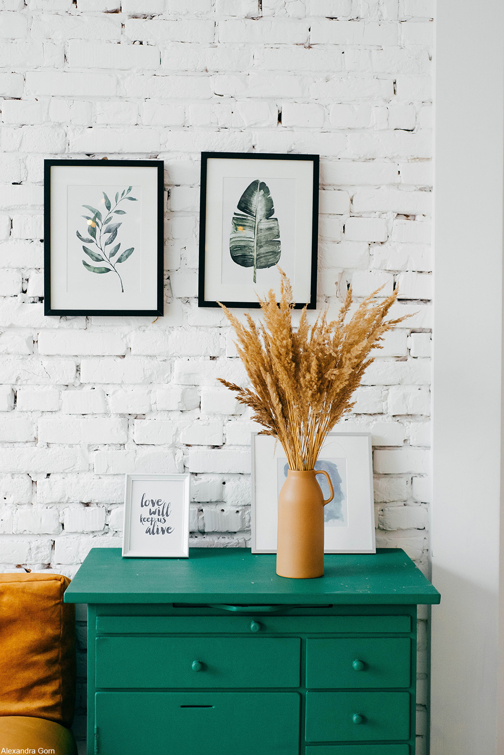 living room with white brick wall and teal accents