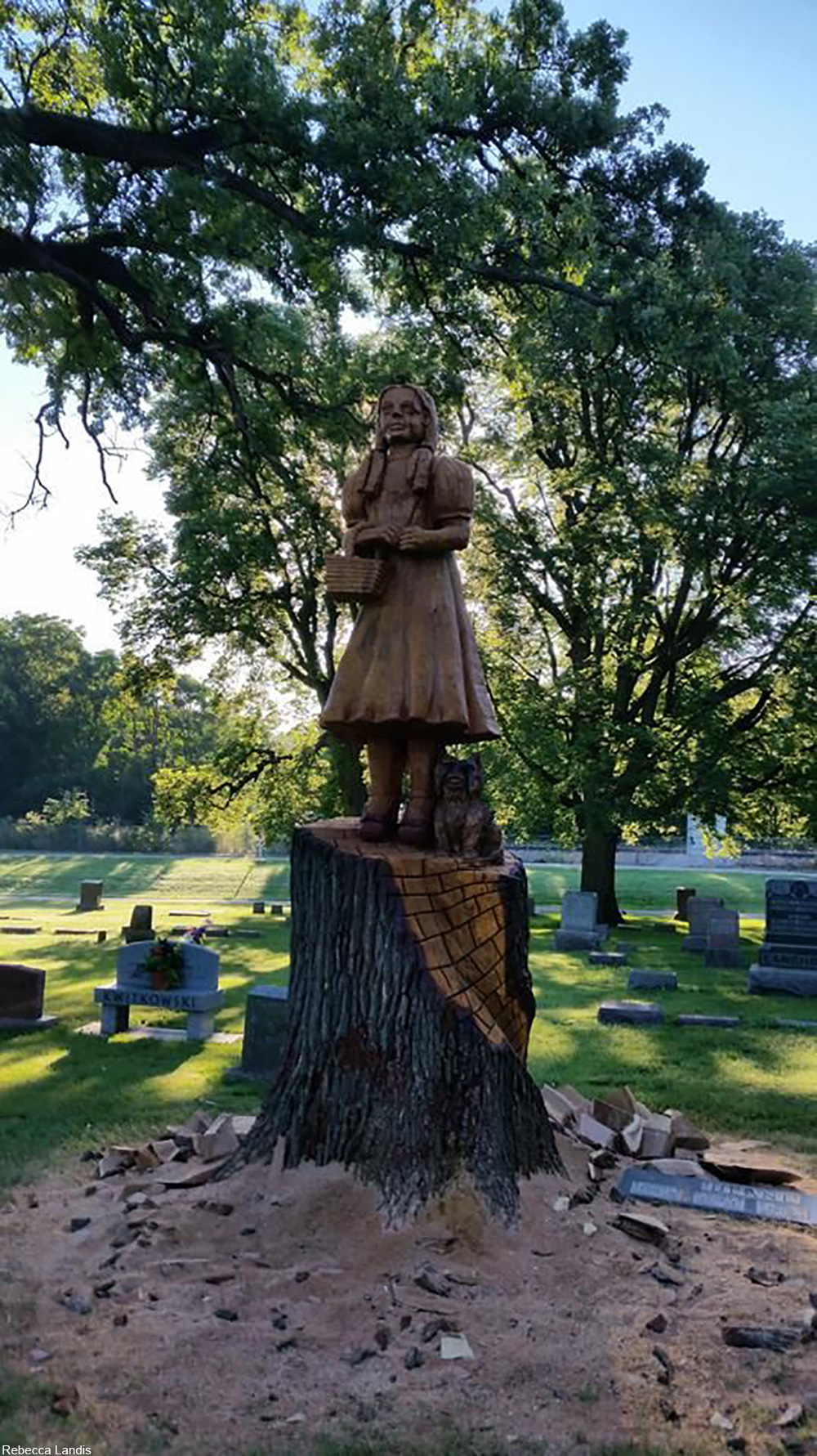 wooden Dorothy Gale statue at the grave of Dorothy Gage, the character's namesake