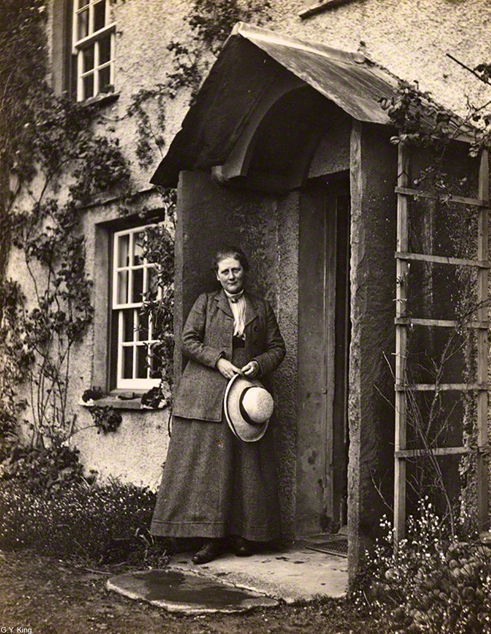 Beatrix Potter on the stoop of Hill Top house, Cumbria