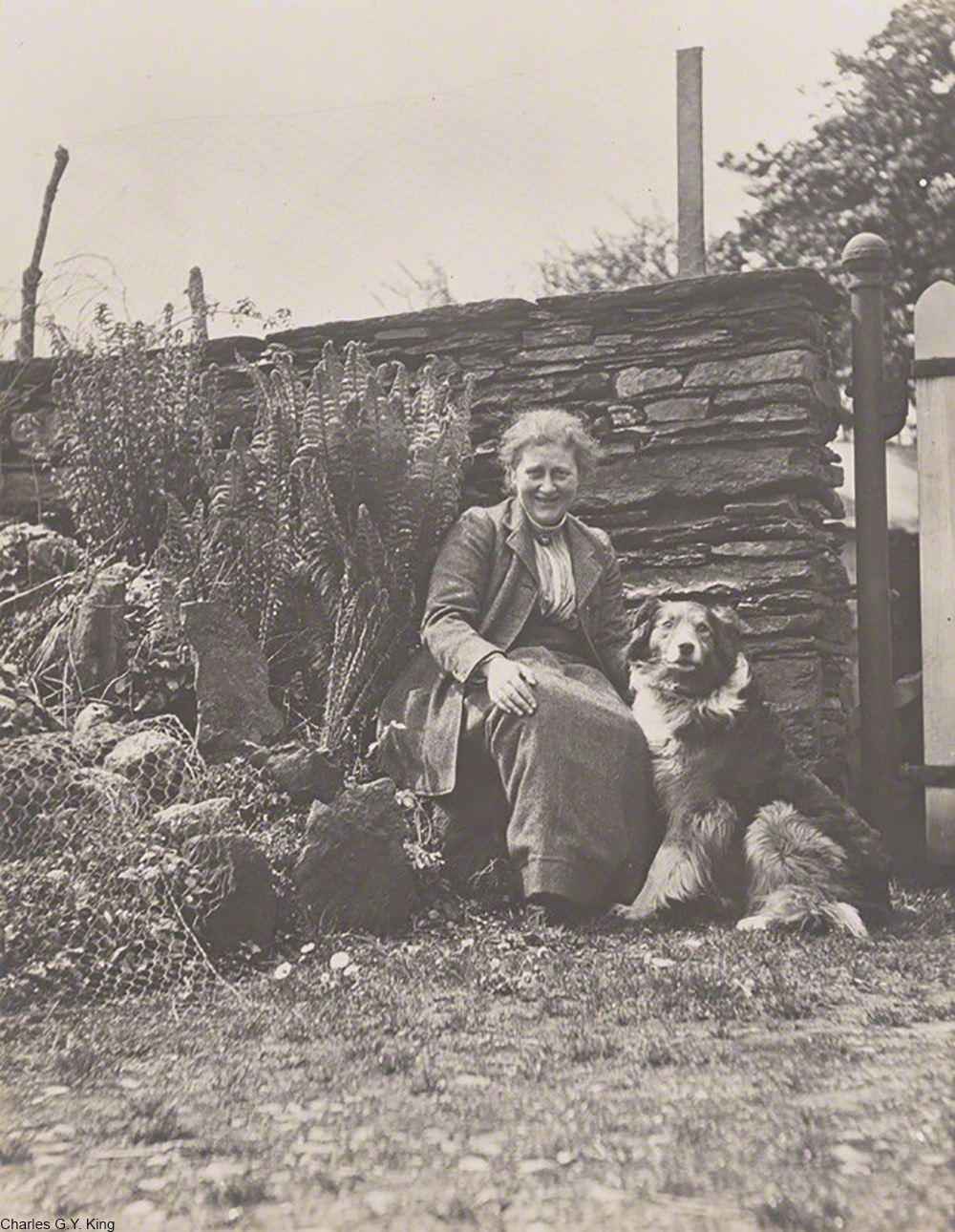 Beatrix Potter and her dog at Hill Top famr