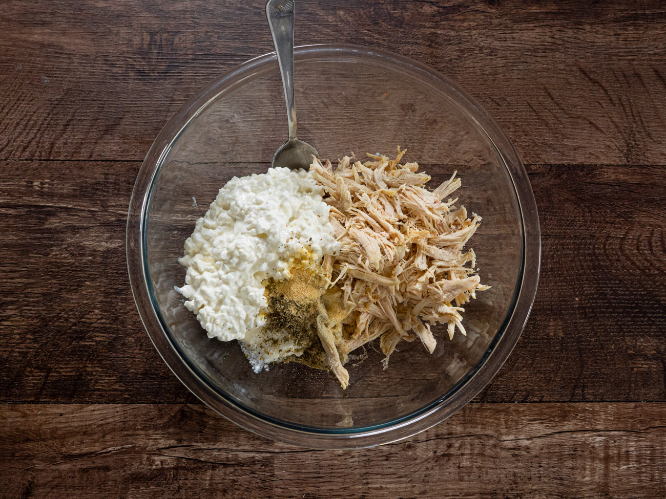 Combine shredded chicken, cottage cheese, salt, onion powder, garlic powder, and Italian seasoning in a large bowl.
