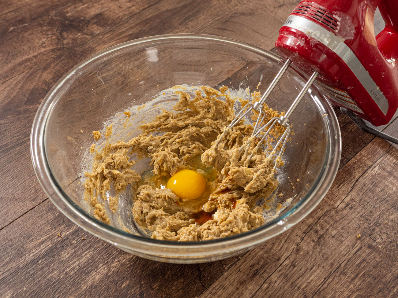 For the outer cookie dough cream together butter and sugar in a large bowl. Add in vanilla and egg and incorporate well.