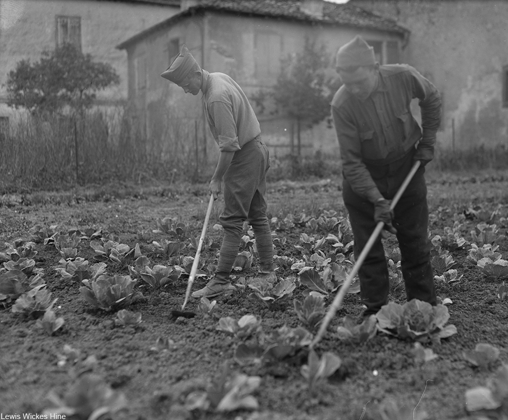 WWI soldiers tending a garden in a convalescent home