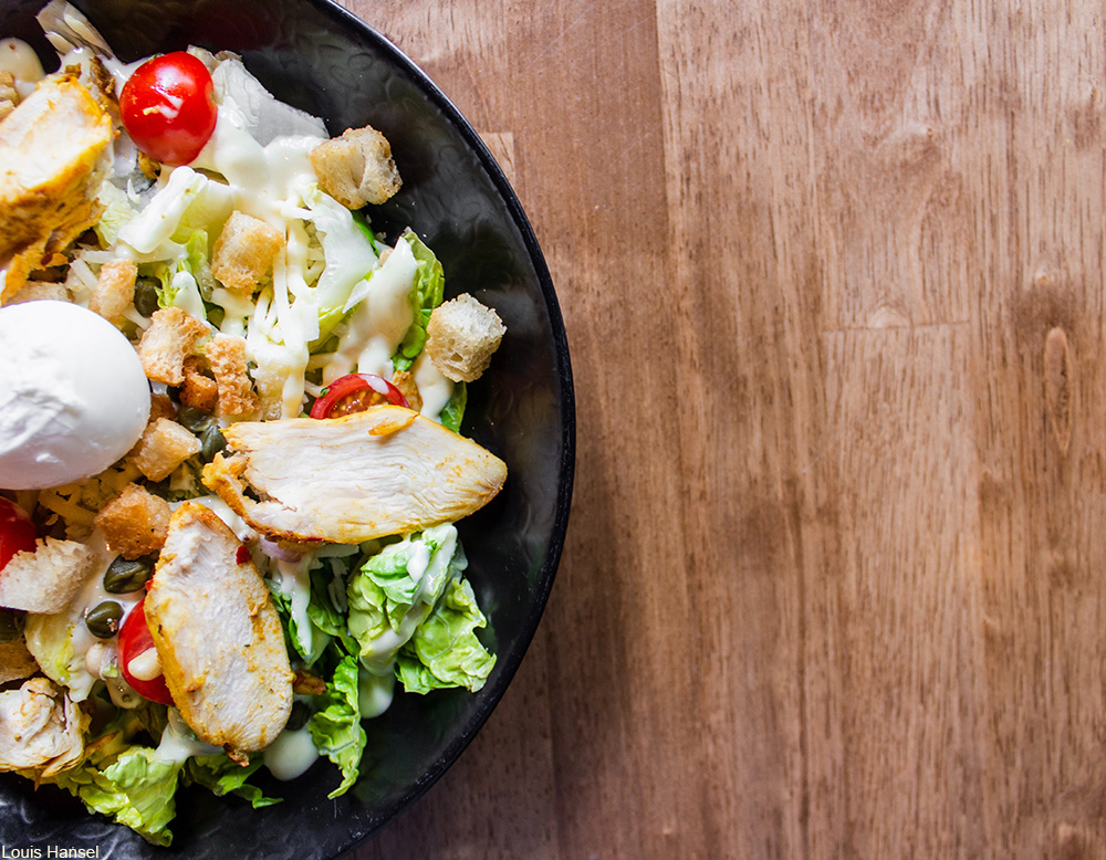 salad with cherry tomatoes and sliced chicken breast