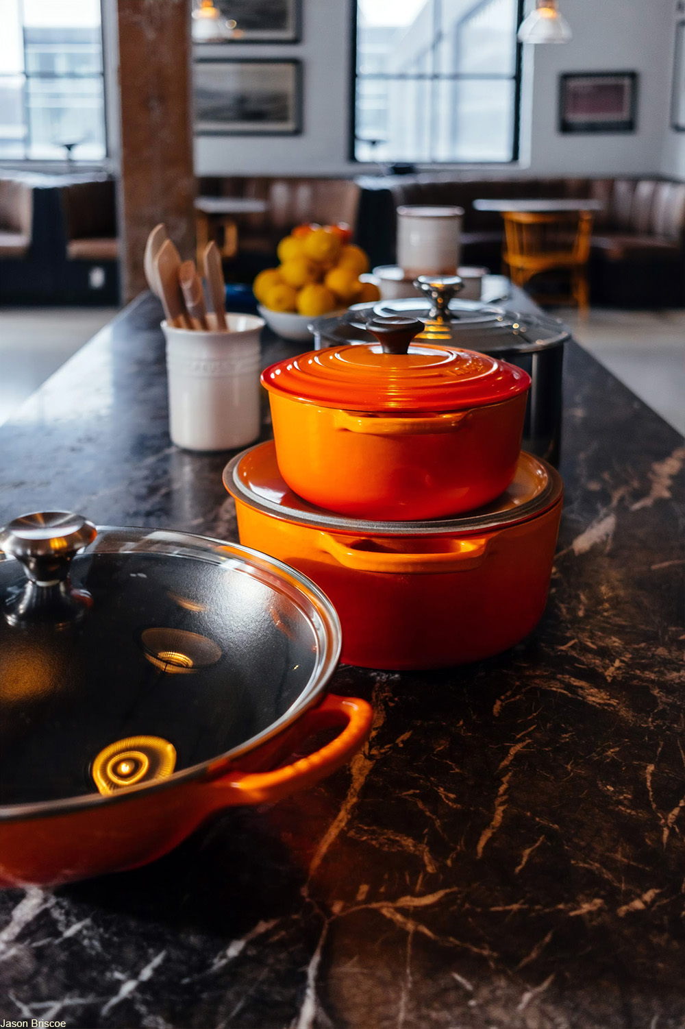 selection of lidded pots and pans on a countertop