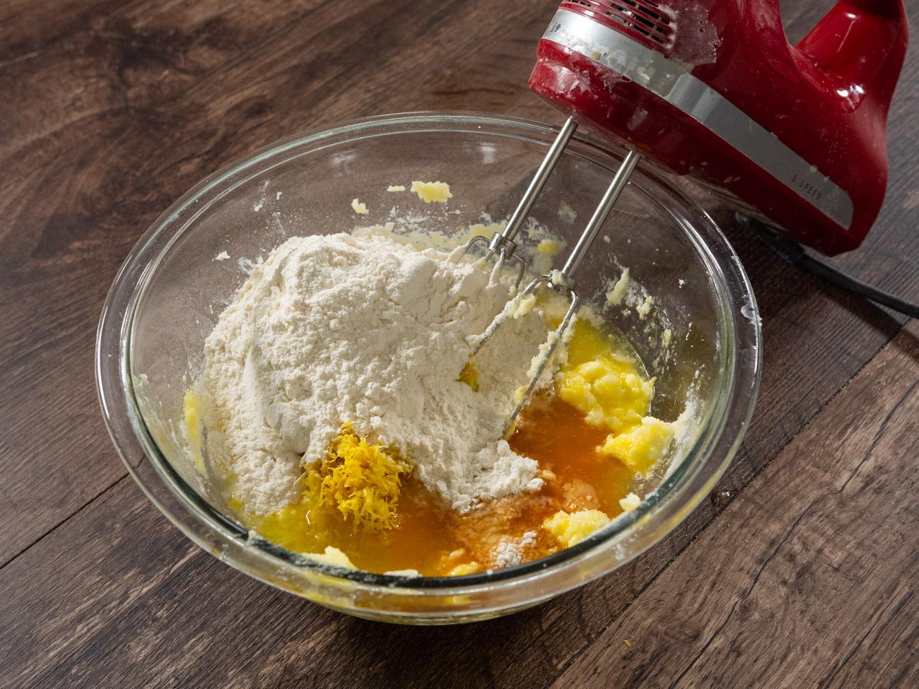 Mix in the lemon juice, lemon zest, salt, vanilla extract, and flour until a soft batter forms.