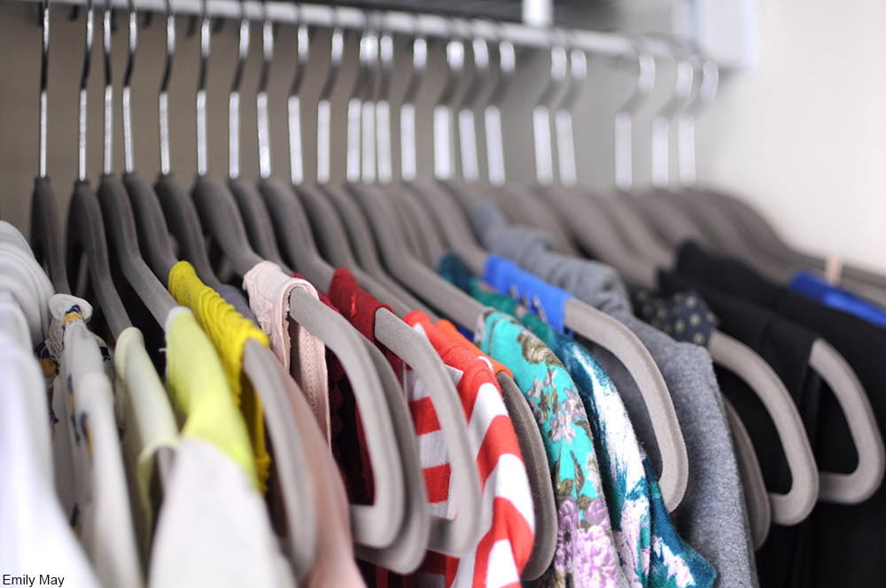 clothes on hangers in closet