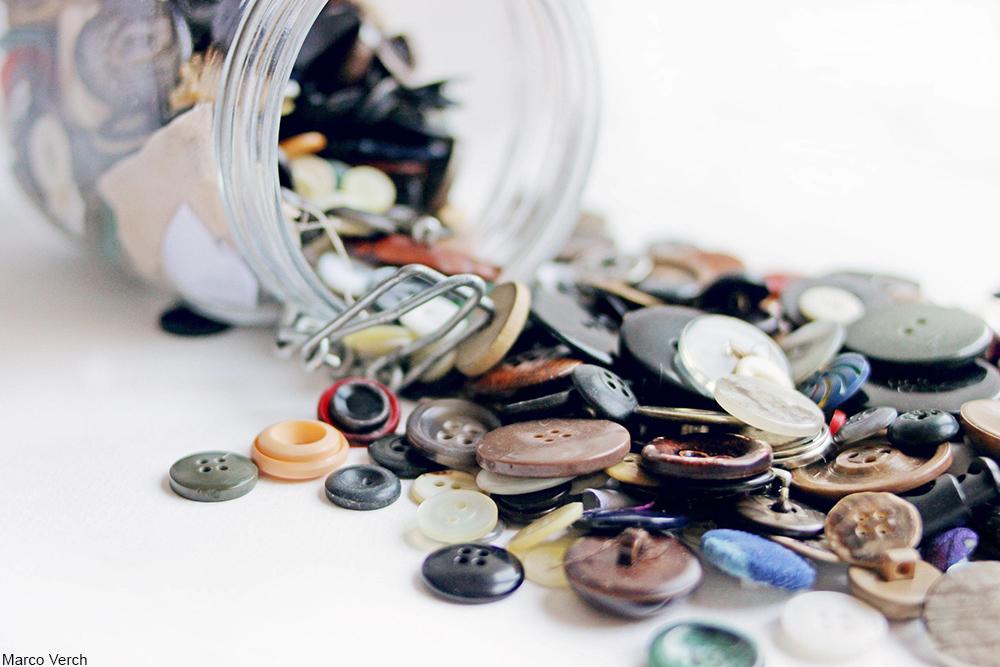 jar of spilled buttons