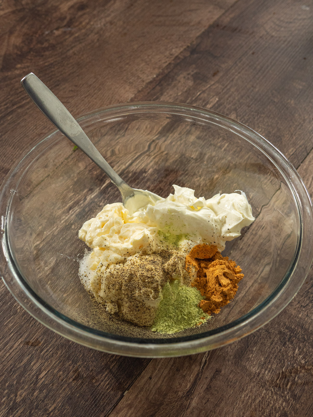 Mix together mayo and sour cream. Stir in salt, pepper, taco seasoning, and ranch seasoning. Add pasta to this and toss until all pasta is coated.