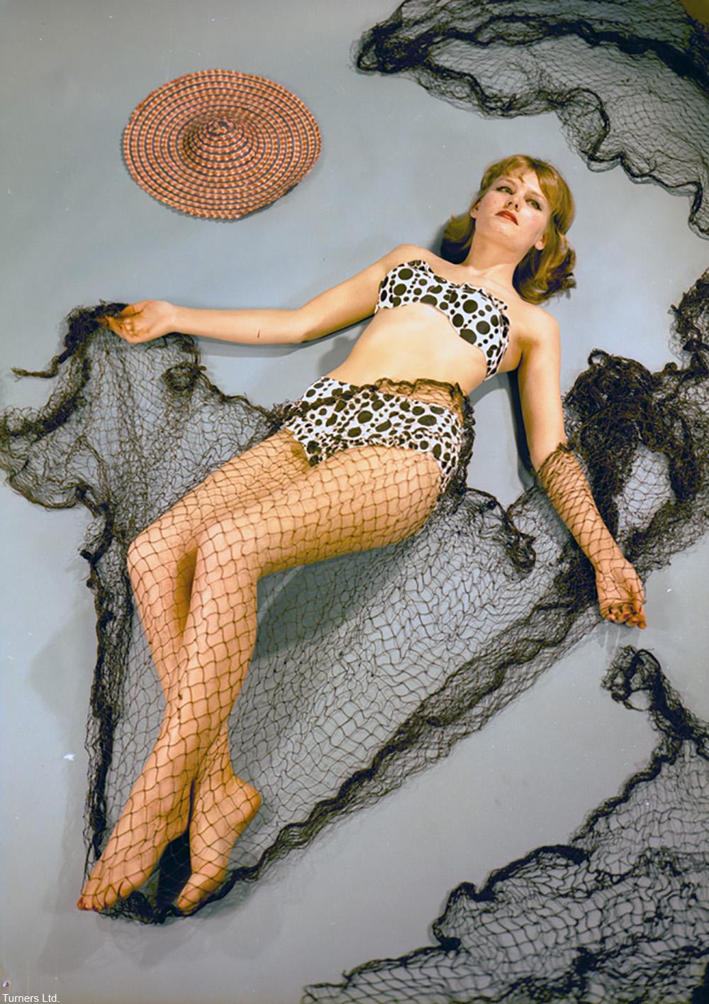 1963 model in polka dot swimsuit