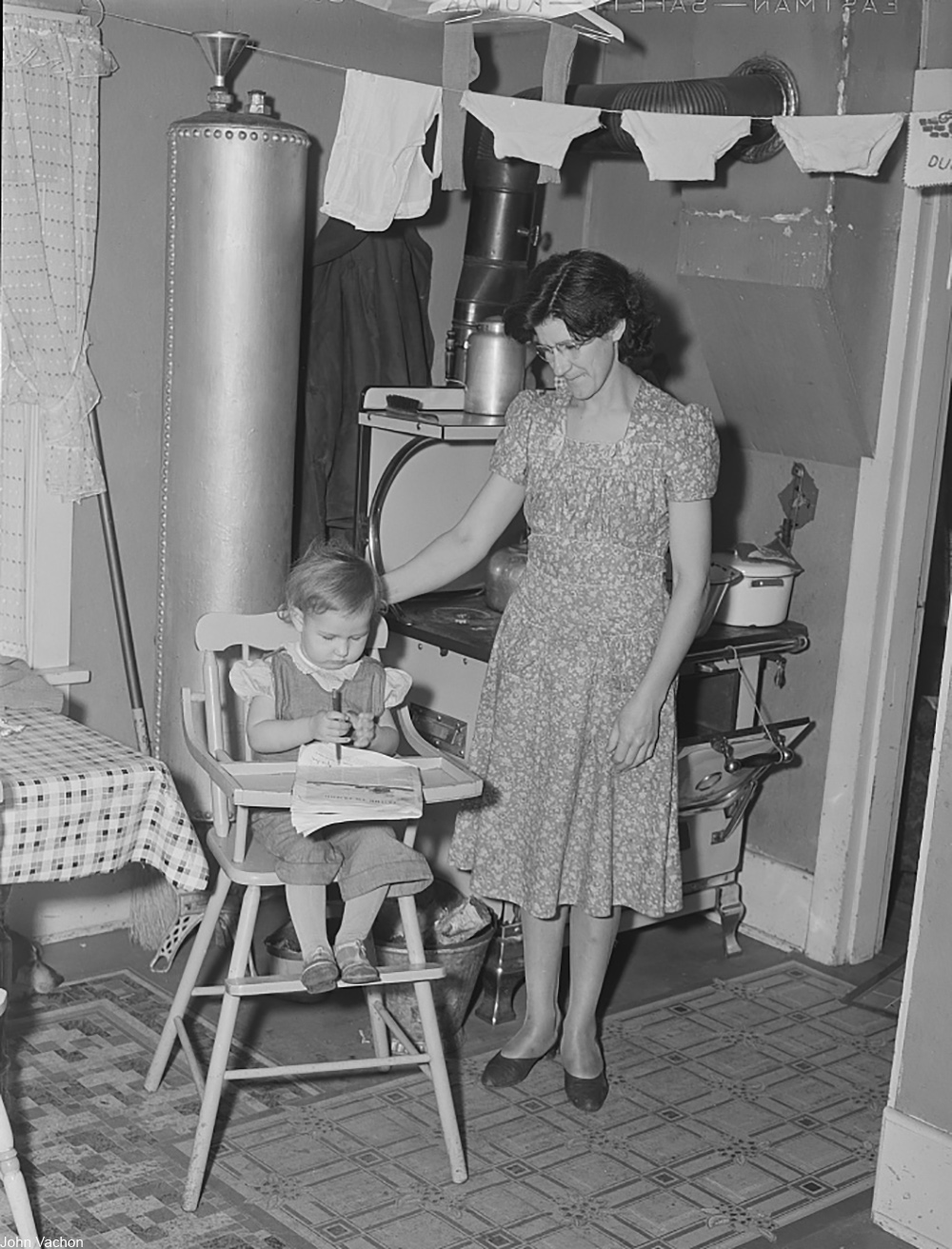 1940s housewife looking after her child