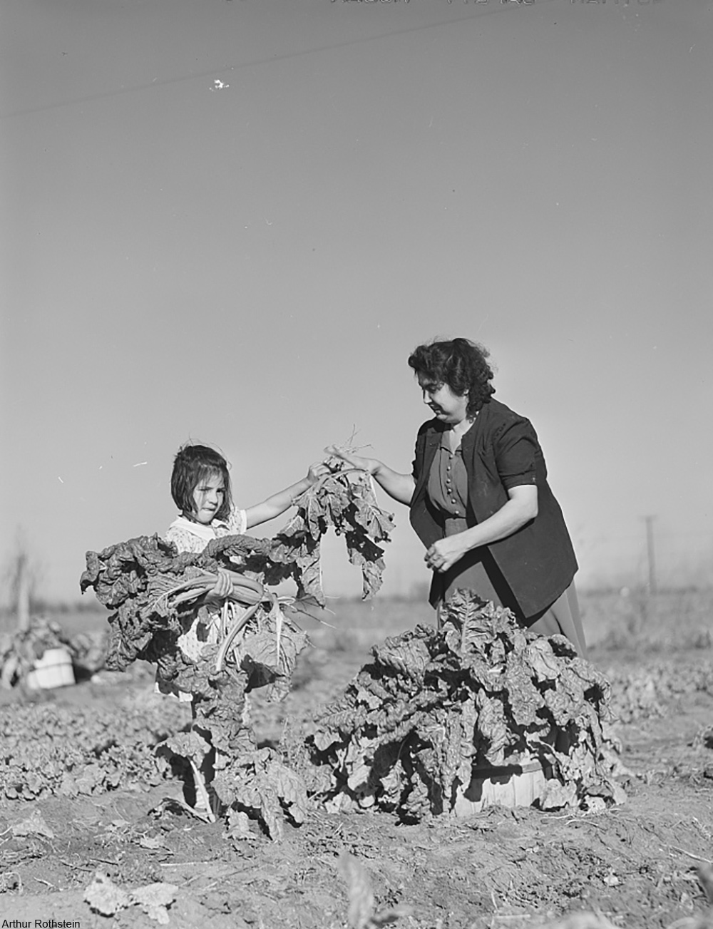 woman and child gardening during the 1940s