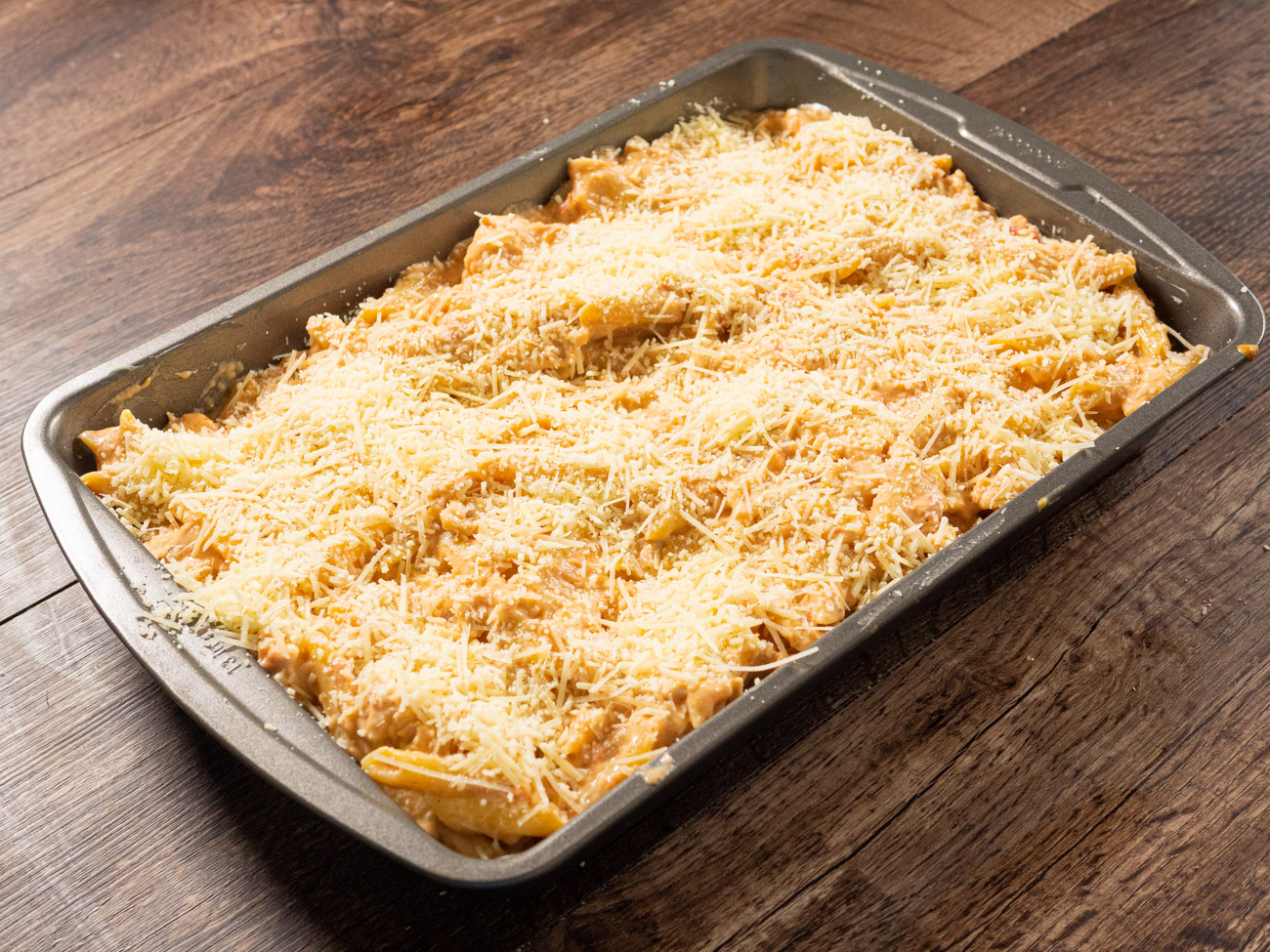 Stir in cooked pasta. Spread into prepared baking dish and top with cheeses.
