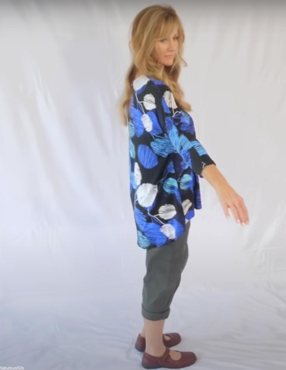 woman wearing baggy top and baggy capri pants