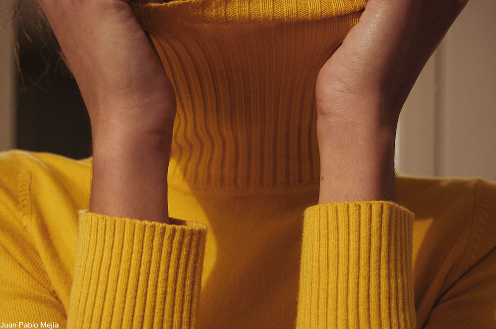woman in a yellow sweater