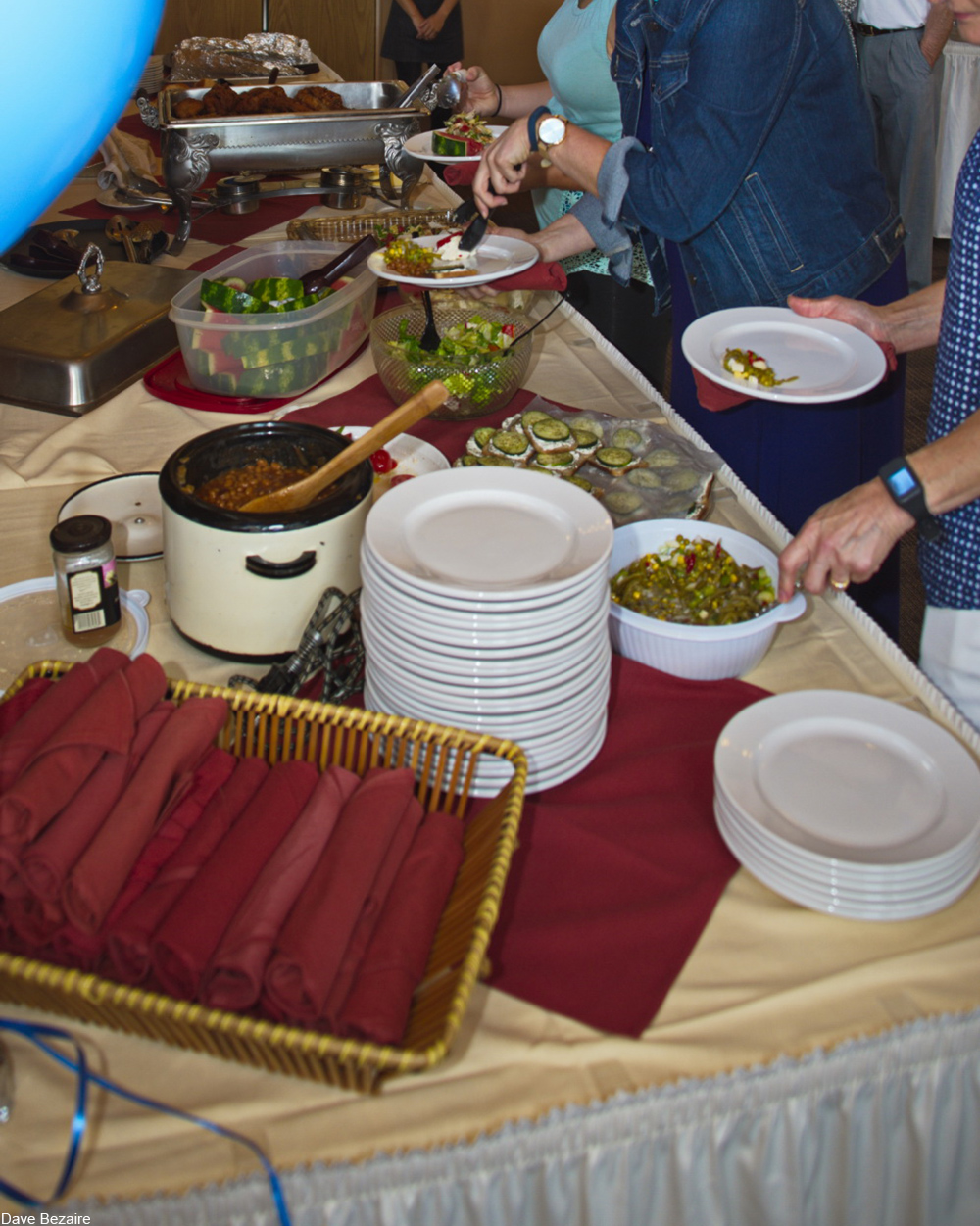 Potluck table filled with food