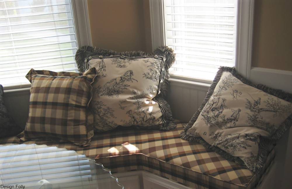 toile pillows in a modern day window seat