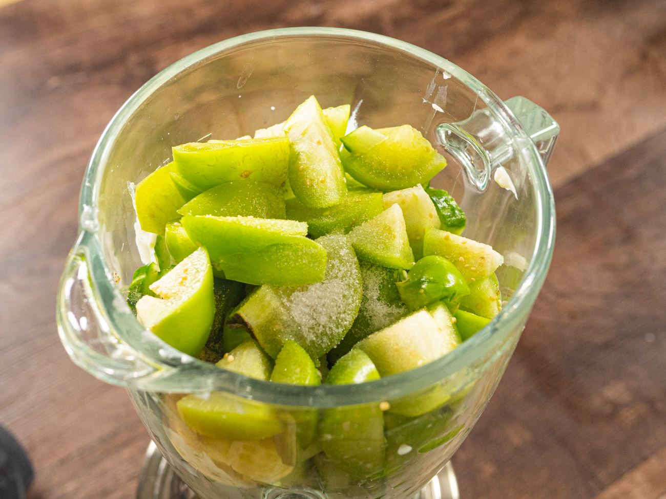 Add yogurt and bread mixture to blender or food processor. To this add cucumber, salt, pepper, sugar, and diced tomatillos.