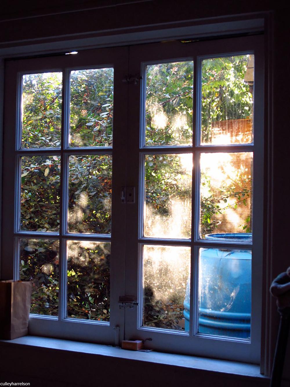 windows showing view of rain barrel outside