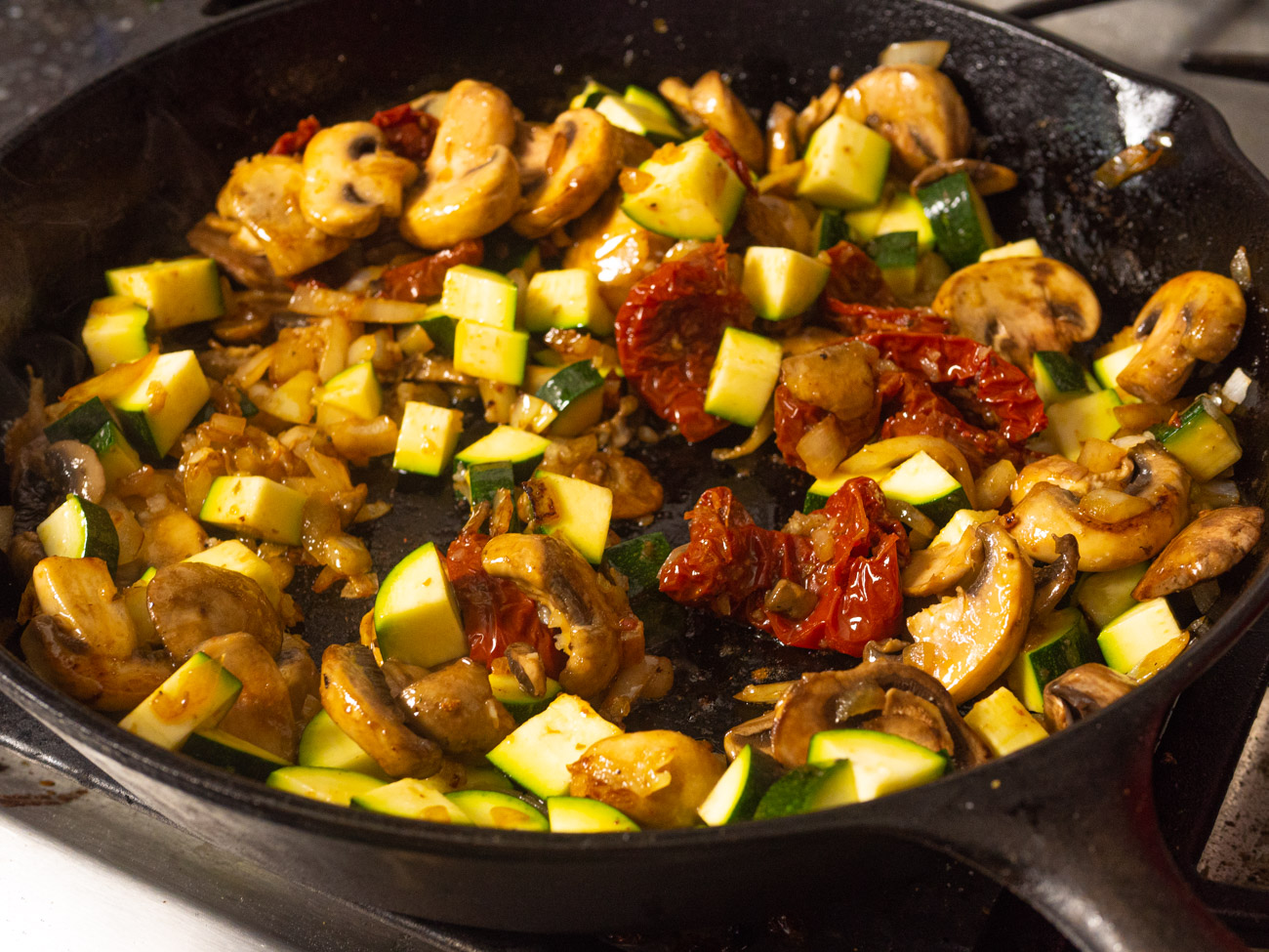 Add garlic, zucchini, and sun-dried tomatoes and cook for 2 minutes. Stir in diced tomatoes, Italian seasoning, and balsamic vinegar. Season to taste with salt and pepper.