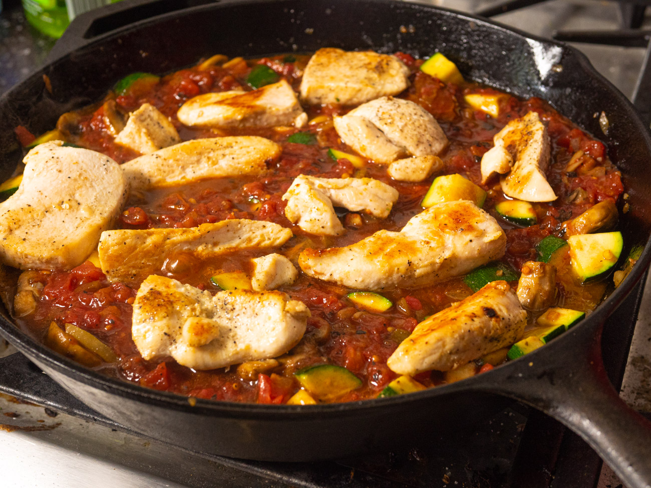 Return chicken to pan and spoon some of the sauce over the top. Cover, reduce heat to medium and cook until chicken is cooked through. Enjoy!