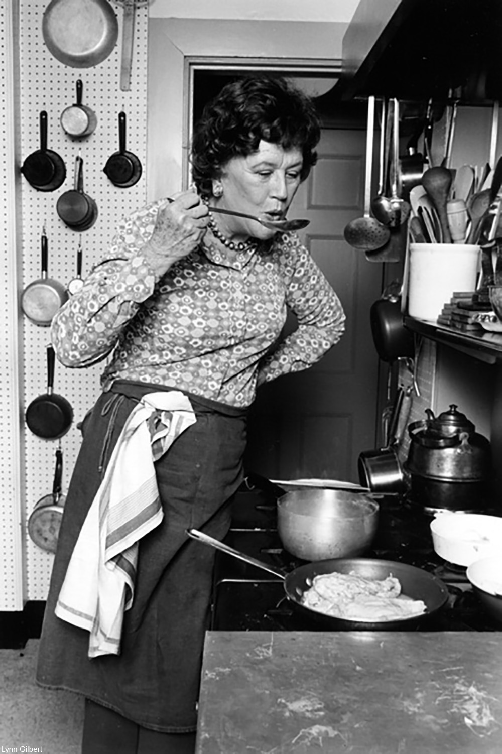 publicity photo of Julia Child in her Cambridge kitchen in the 1970s