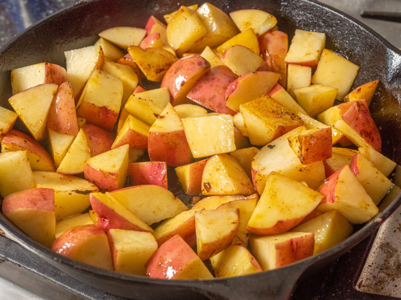 In the same skillet add 1 tablespoon olive oil and cook the potatoes for about 10 minutes. Add potatoes to casserole dish.