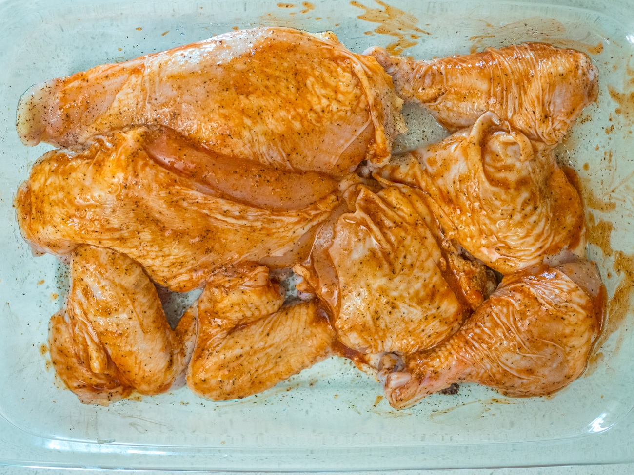 Cut chicken into pieces if whole. Season meat with hot sauce, salt, and pepper. Use 1 cup of the flour to dust the chicken pieces.