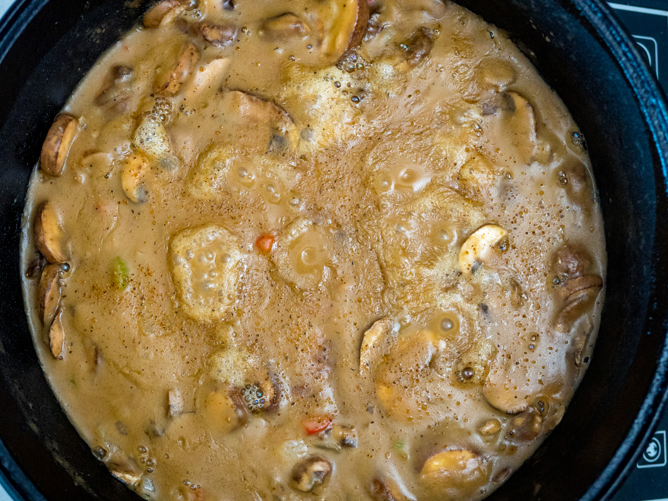 Add chicken stock a little at a time, stirring well after each addition. Add in Cajun seasoning.