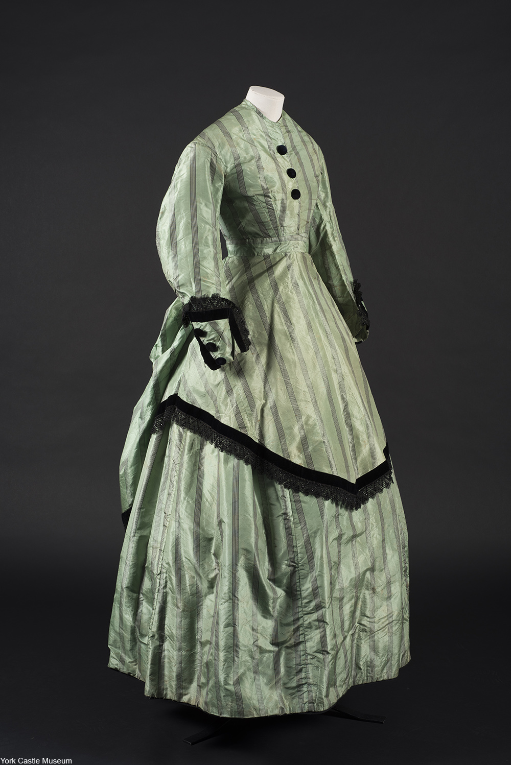 Victorian dress in green and black made with arsenic dyes that is still leeching poison