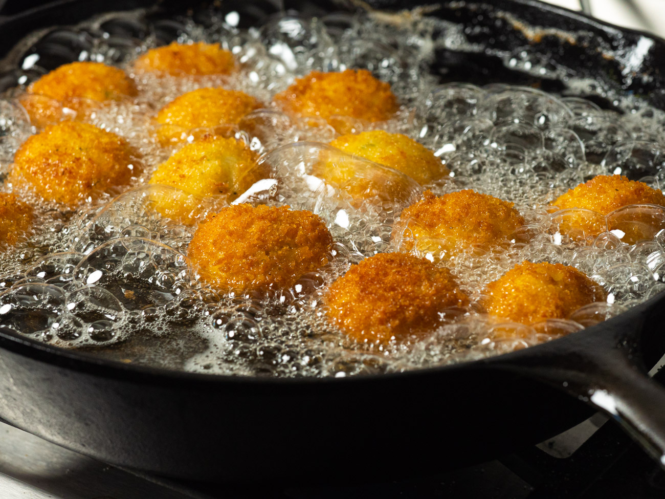 Fry until golden brown, about 3-4 minutes per small batch. Set aside to drain on paper towels before serving.